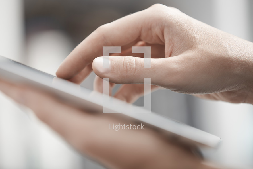 fingers on a tablet
