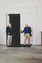 greeters holding the doors open