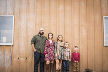 family portrait in front of a barn