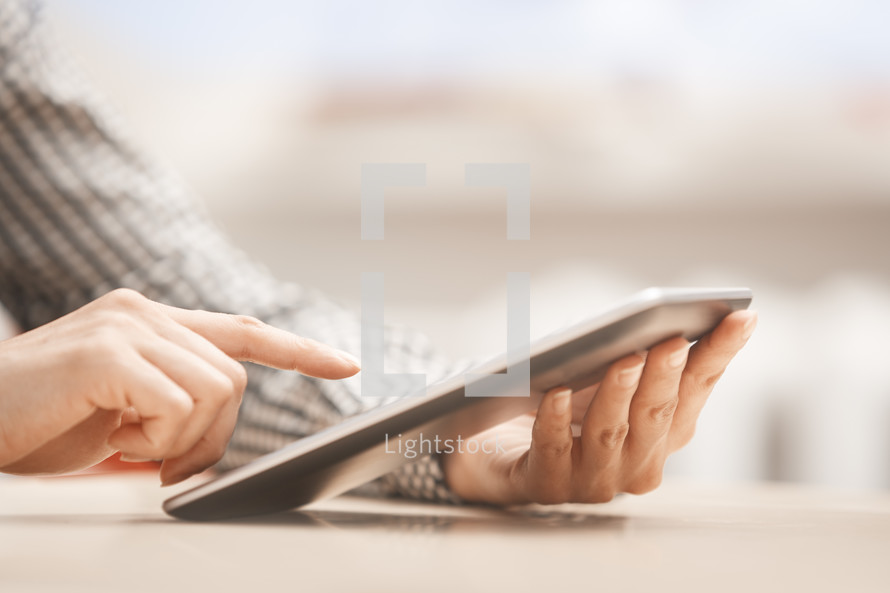 a woman using a tablet at work
