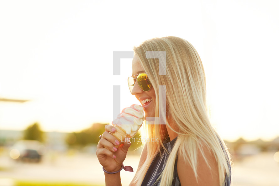a woman eating an ice cream cone