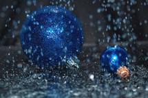 blue Christmas ornaments in rain