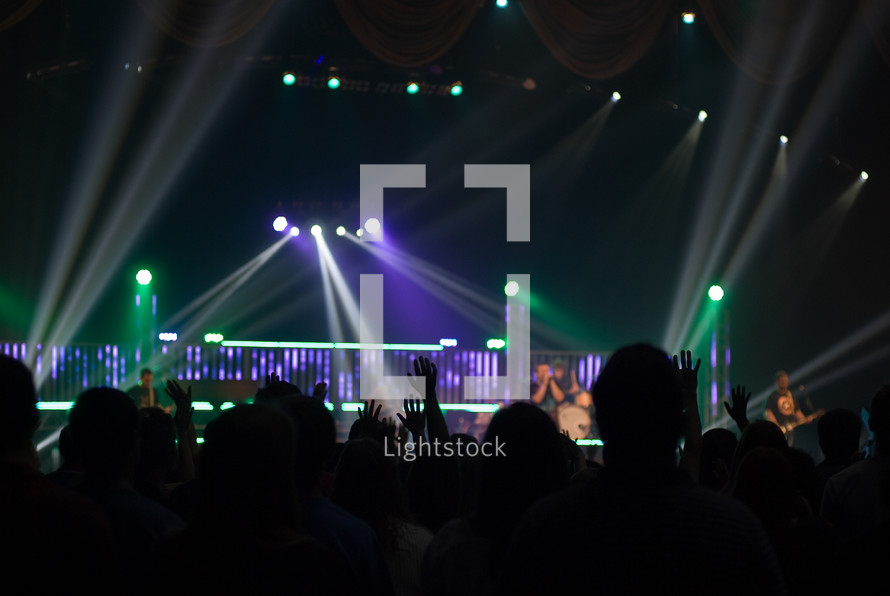silhouettes, spot lights, stage, stage lights, audience, fans, concert, man, woman, raised hands