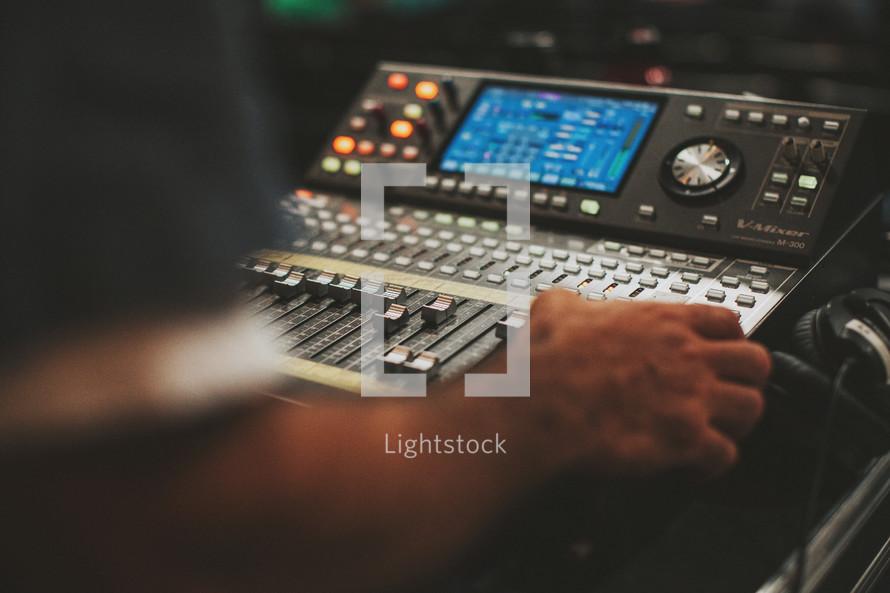 man at a soundboard