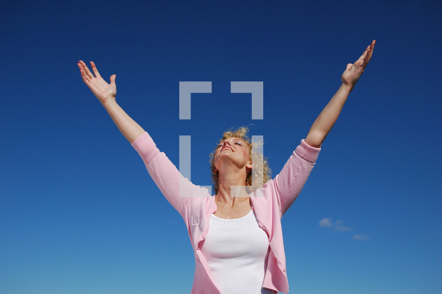 woman holding her hands up in a V