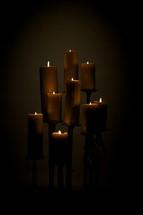 Lit candles on a candelabra