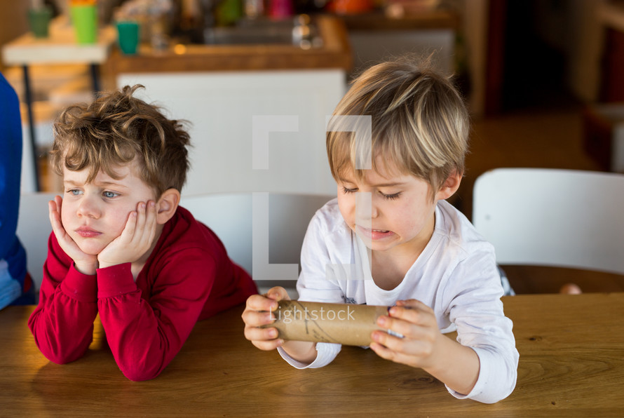 boys opening a container of crescent rolls