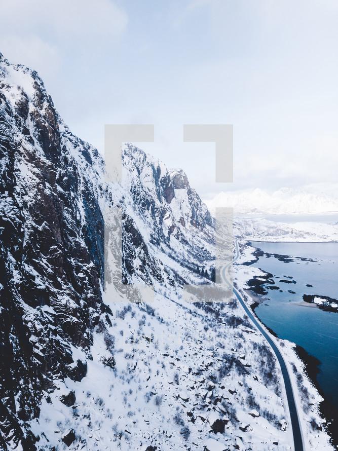 road along a winter shoreline