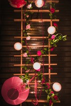 pink paper lanterns and flowers centerpiece
