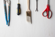 Tools lined up on a white background.