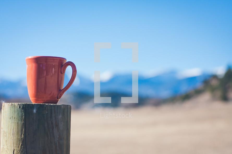 coffee mug on a post
