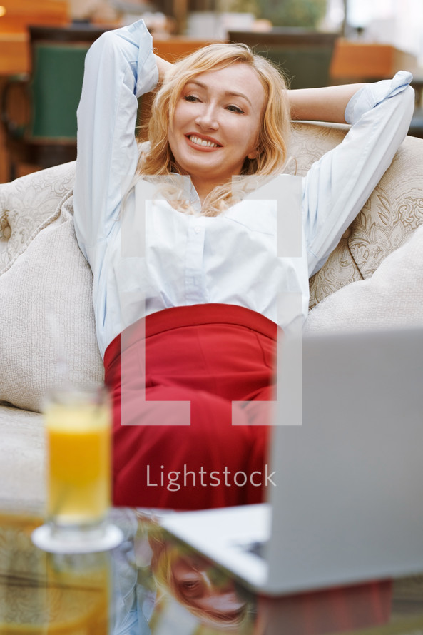 woman relaxing in a lobby
