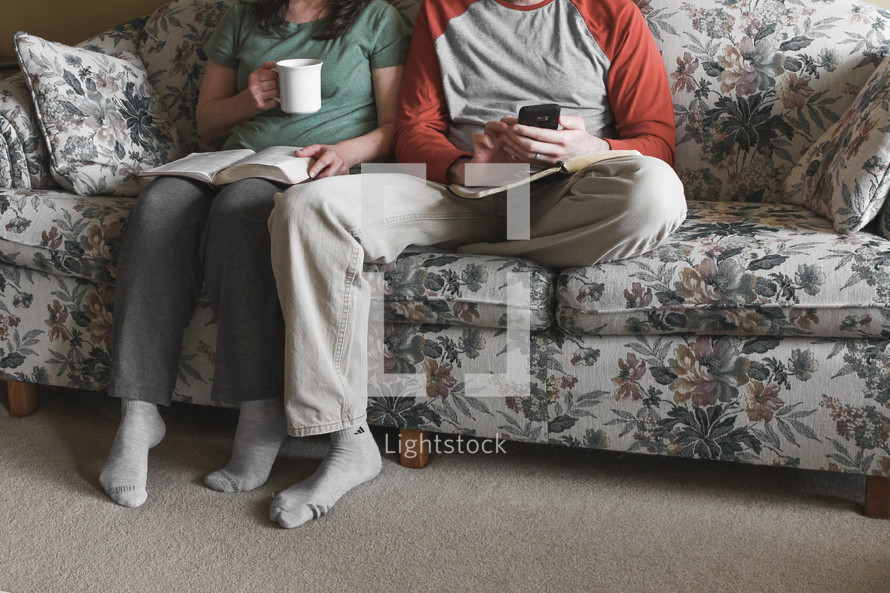 couple sitting on the couch watching church online