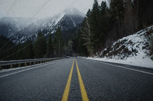 power lines over a winter mountain highway