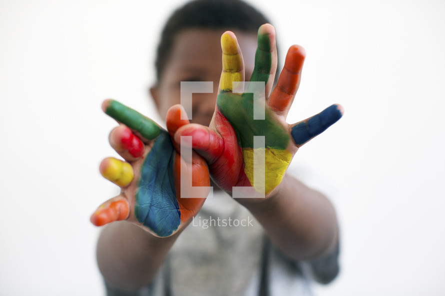 a little boy with painted hands