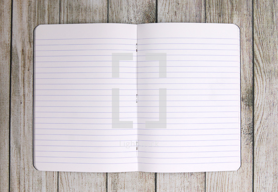 blank paper in an open notebook