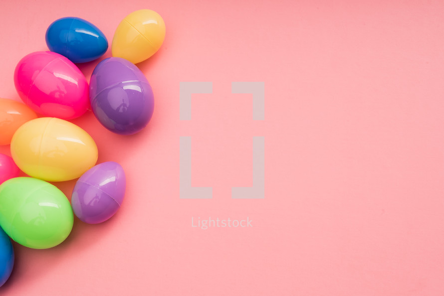 plastic Easter eggs on a pink background