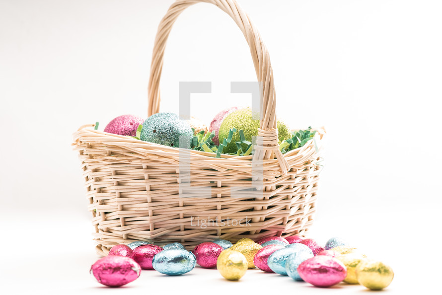 Easter eggs in a basket and Easter candy