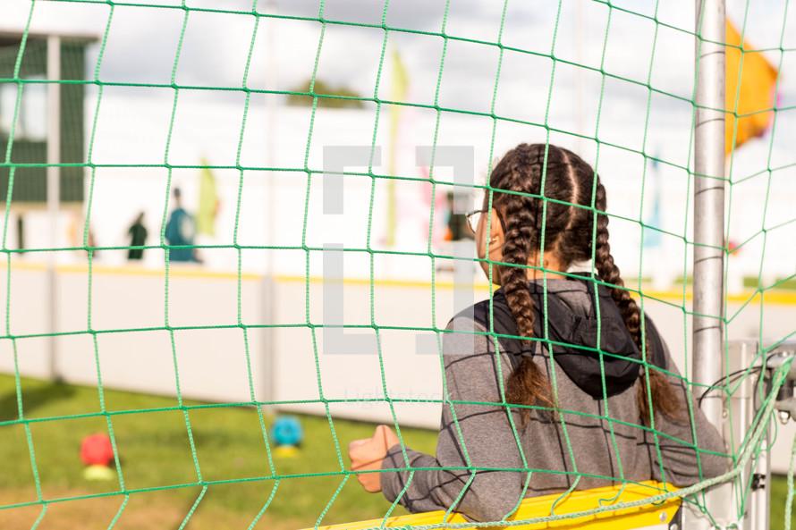girl in a soccer goal