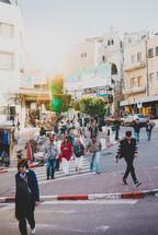 pedestrians on a crowded sidewalk