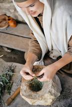 a woman grinding herbs