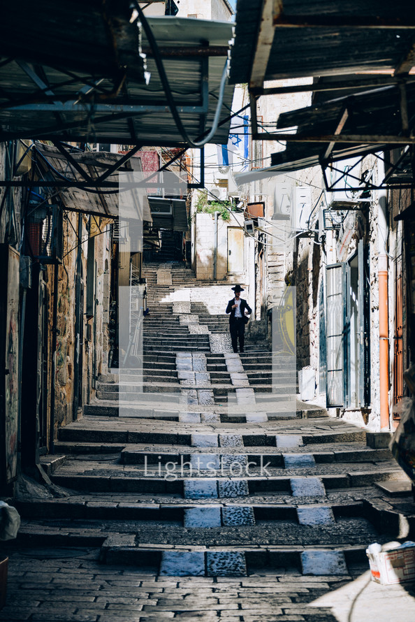 steps on a cobblestone alley