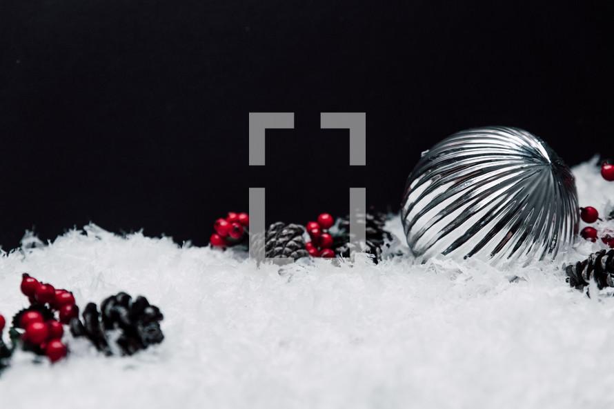 silver ornaments in snow