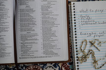 rosary, Bible, and prayer list