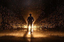 man standing in a glowing wet tunnel