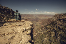 sitting looking out over the Grand Canyon