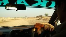 driving through a bumpy desert road