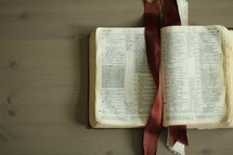 an open Bible on a coffee table