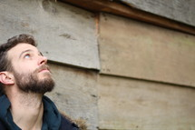 bearded man looking up