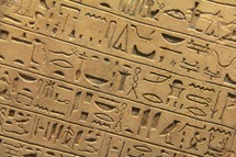 Egyptian hieroglyphics set in clay