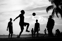 playing soccer on a beach