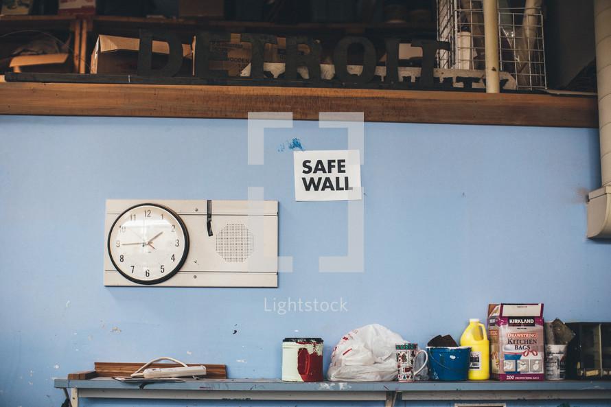time clock, safe wall, paint, workshop