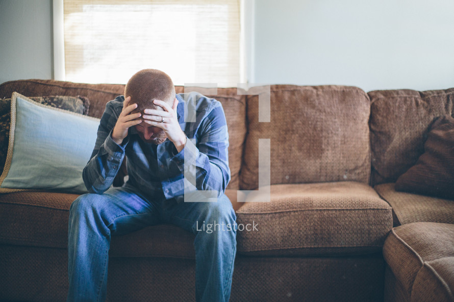 A sad and stressed man.