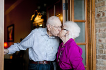 Elderly couple kissing