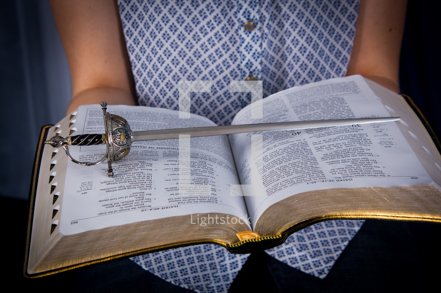 Sword on pages of an open Bible.
