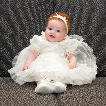 baby girl in a Christening gown