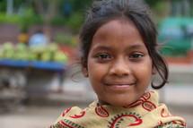 Lower caste Hindu girl in local vegetable market.