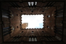 looking up at the sky through a cathedral's tower