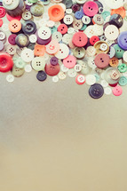 pile of buttons border
