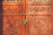 padlock on red doors in China