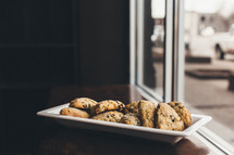 cookies on a plate in a window