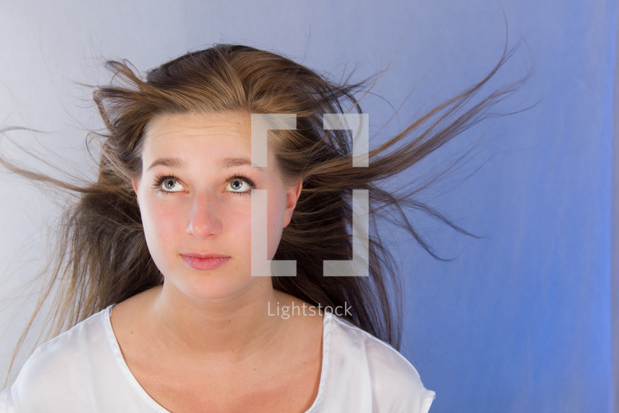 woman with her hair blowing