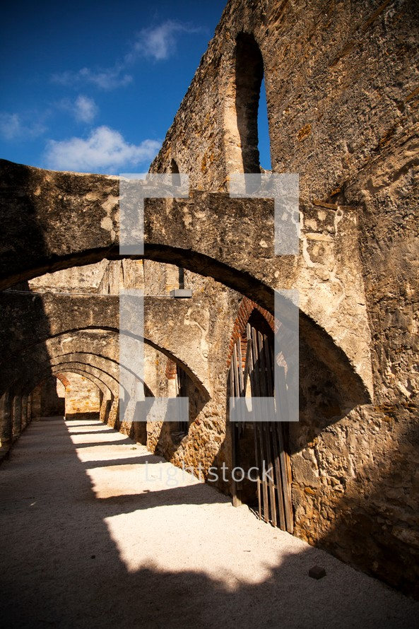 arched walkway at old Spanish Mission