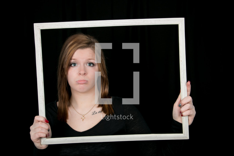 frowning woman in a frame