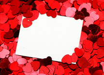 blank white sign surrounded by red hearts