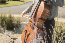 man playing a bass outdoors